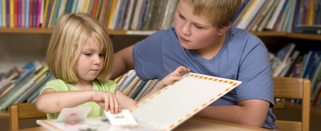Siblings are able to step away from the medical setting and enjoy a quiet moment reading together.